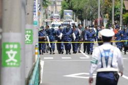 Доктор стрелял в полицейских возле школы в Токио после ссоры с бывшей женой