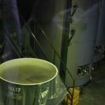 И вон в тех герметично закупоренных чанах тоже. Для каждого сорта вина - свой чан и свои условия. Внутрь этого цеха посторонних не пускают, мы смотрели через стекло галереи сверху. Тут поддерживается постоянная и вполне определенная температура